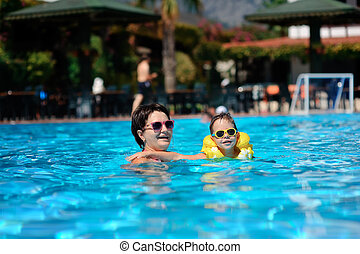 Family rest in pool