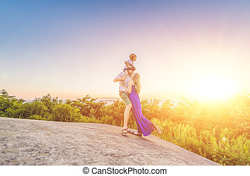 family resting at sunset in the park