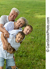 Family resting in summer - Two boys with their grandparents...
