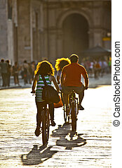 family riding a bicycle in the city