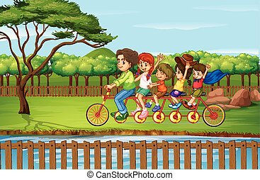 Family riding bike in the park