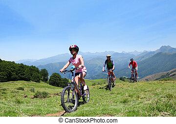 Family riding bikes in the mountains