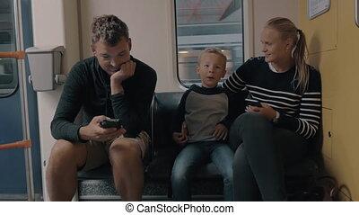 Family riding in underground train