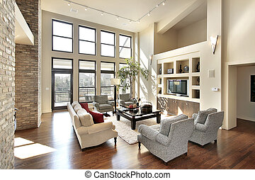 Family room in open floor plan with windows to balcony
