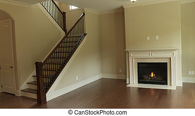 Family Room - Empty family room with fireplace and staircase