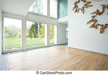 Family room - Stylish empty family room overlooking the...