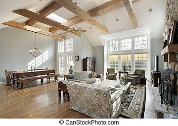 Family room in luxury home with ceiling wood beams
