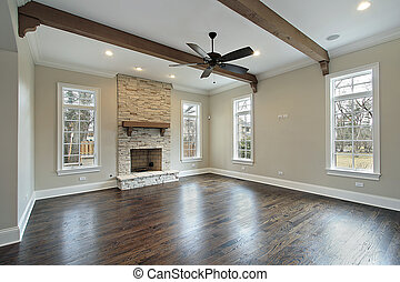 Family room in new construction home with ceiling wood beams