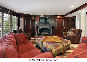 Family room with cherry wood cabinetry