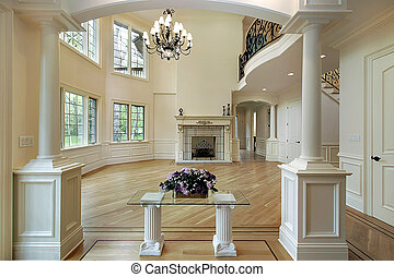 Family room with columns, fireplace and balcony
