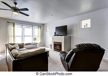 Family room with fireplace and TV