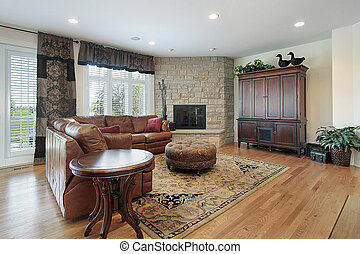 Family room with fireplace - Family room in luxury home with...