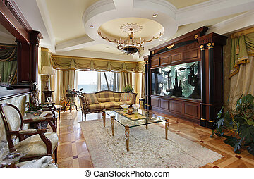 Family room with large fish tank - Family room in upscale...