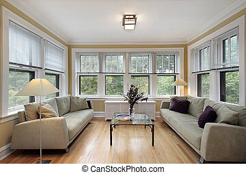 Family room in condo with wall of windows