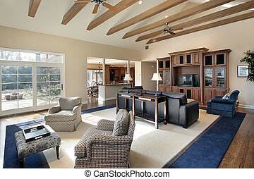 Family room in suburban house with wood beams