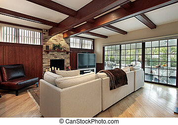 Family room with wood beams and porch view