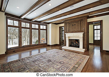 Family room in new construction home with wood ceiling beams