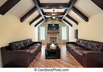 Family room in suburban home with wood celing beams