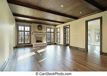 Family room in new construction home with wood ceiling
