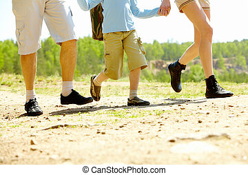 Family running - Image of happy family legs running down...
