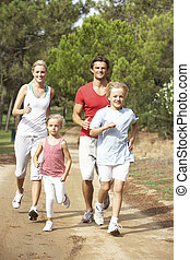 Family running on path in park
