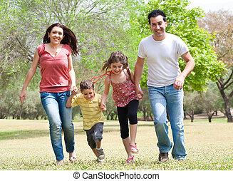 Family running on the park
