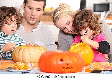 Family sculpting pumpkins
