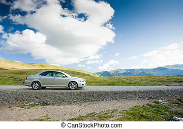 Family sedan outdoors in a remote location - holiday concept
