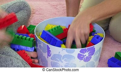 Family selects colorful toy bricks