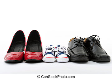 Family shoes - Women, kid, and men shoes on white...