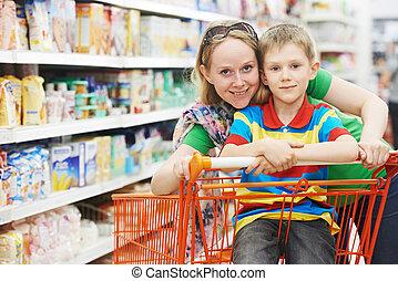 Family shopping at supermarket