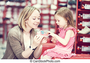 family shopping choosing child footwear shoes - Family...