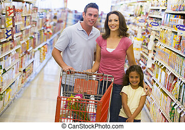 Family shopping in supermarket - Family shopping for...