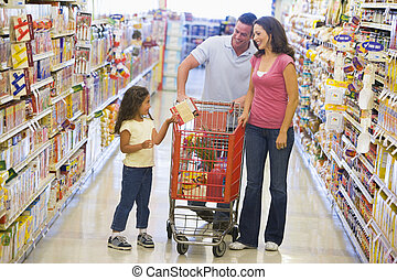 Family shopping in supermarket