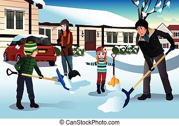 Family shoveling snow in front of their house