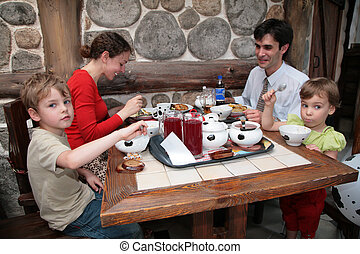 Family sit in cafe