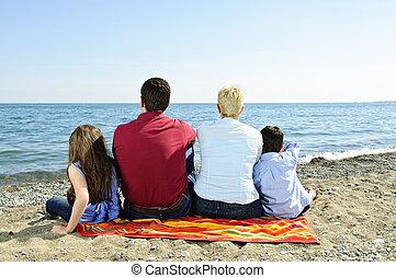 Family sitting at beach