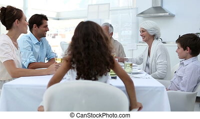 Family sitting at dinner table