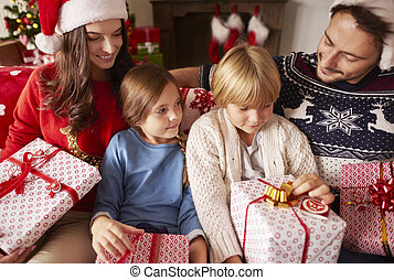 Family sitting at home with Christmas presents