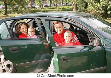 family sitting in car 2