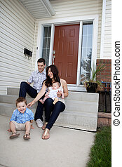 Family Sitting on Steps