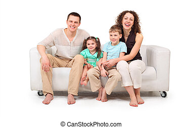 Family sitting on white leather sofa