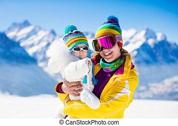 Family ski and snow fun in winter mountains