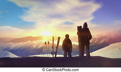 Family skiers on top of the mountain.