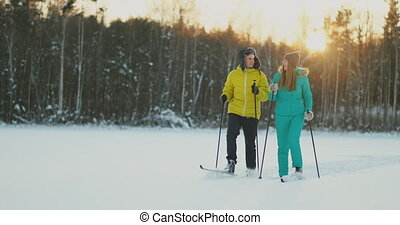 Family skiers spend the weekend together doing skiing in the...