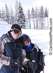 Family skiing - Father and daughter enjoying downhill skiing...