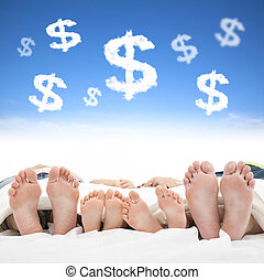 family sleeping on the bed with money sign concept