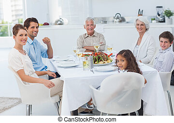 Family smiling at the dinner table