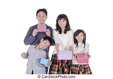 family smiling holding gift