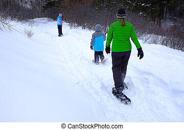 Family Snowshoeing in the Winter Snow